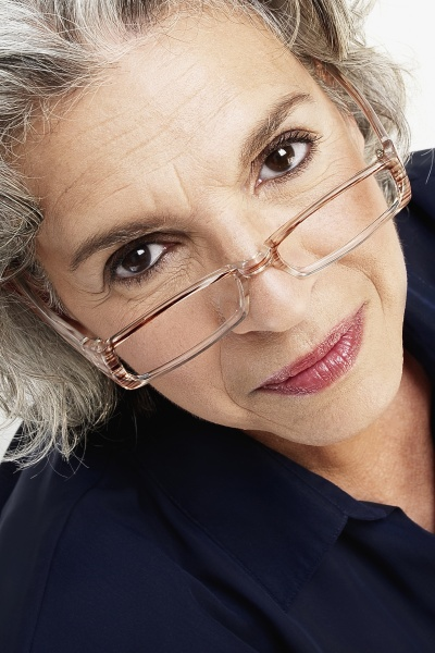 portrait of a mature woman peeking
