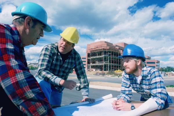 construction crew looking at blueprints