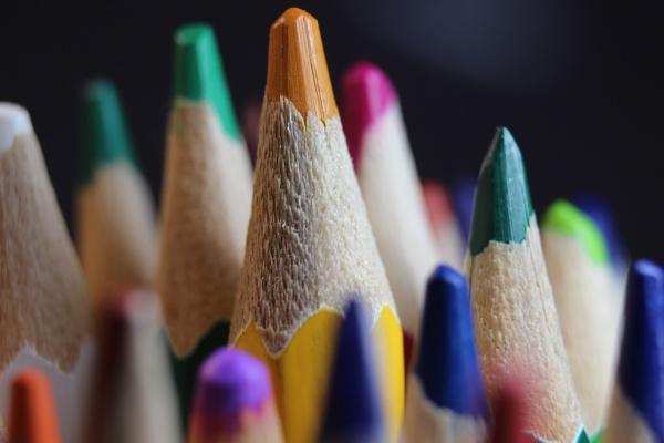 bright colored multicolor pencils on black