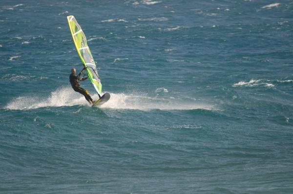 windsurfer sailing in the coast of