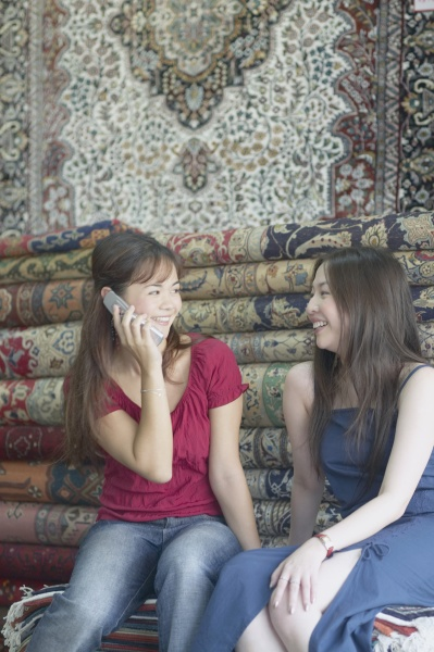 two young women sitting in a