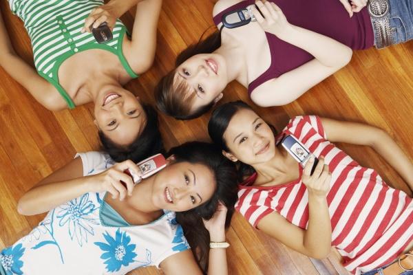 portrait of four young women lying