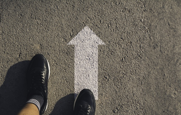 a person standing at the crossroad