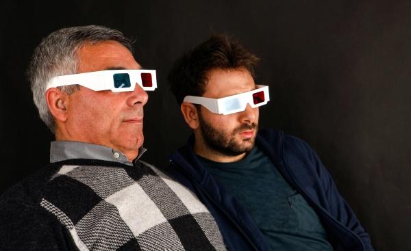 two men wearing 3d glasses