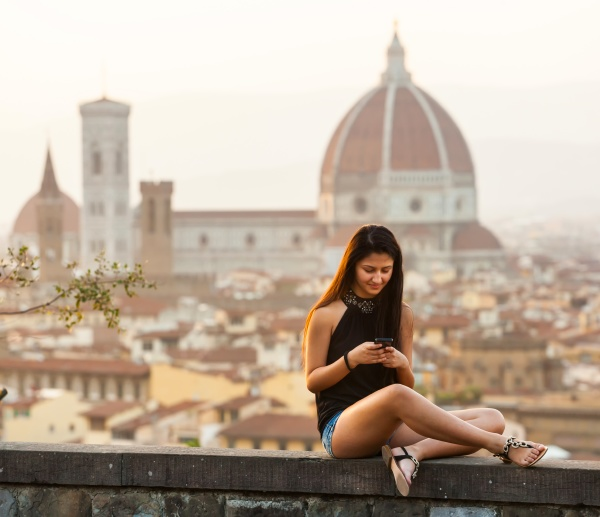teen at sunset in florence uses