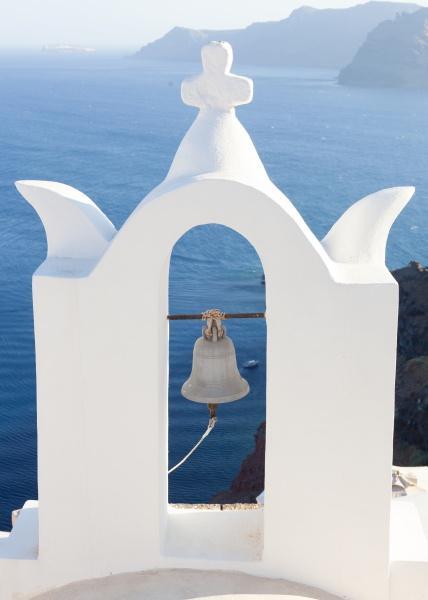 white bell tower at oia santorini