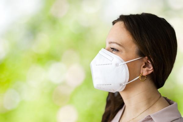 woman with coronavirus ffp2 face mask