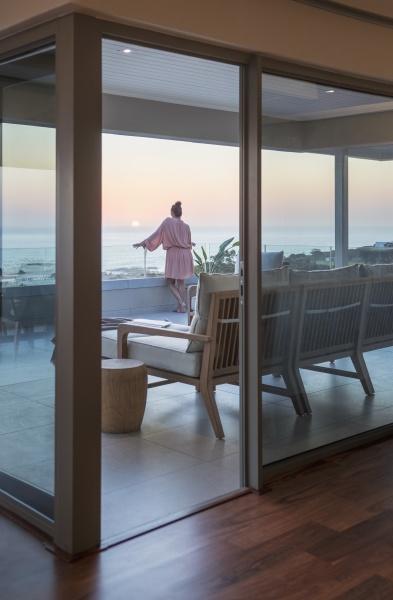 woman enjoying scenic sunset ocean view