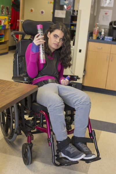 young woman in a wheelchair with