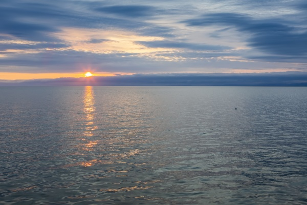 sunset over the water of kotzebue