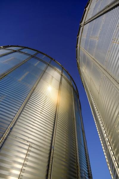 silver metal grain storage bins against