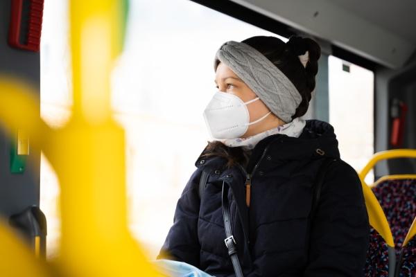 woman in public bus transport