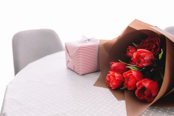 bouquet of red tulips on table