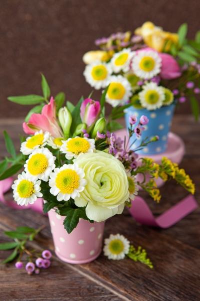 fresh spring flowers in little vases