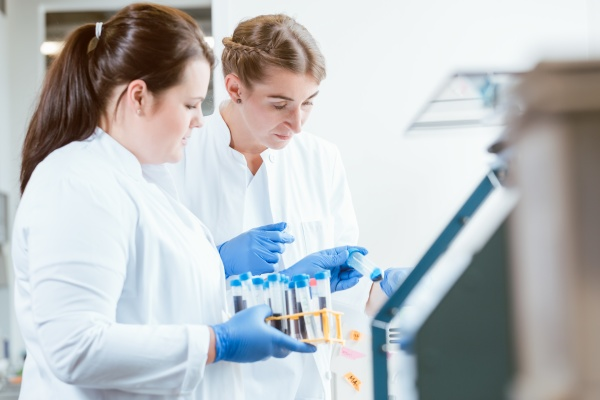 female scientists looking at samples in