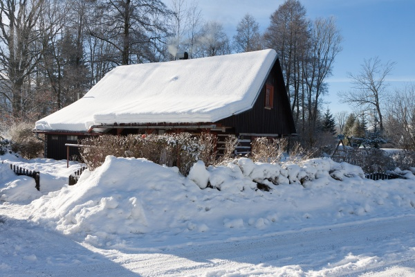 traditional wooden cottage in winter