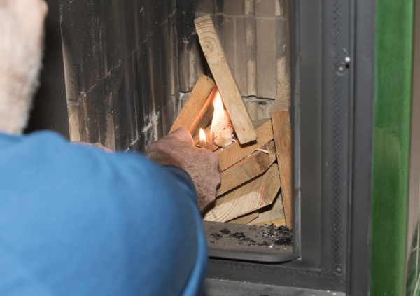 heating up a tiled stove