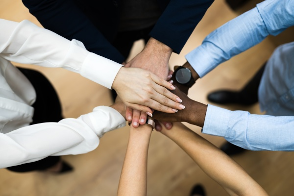 diverse business people hands stack community