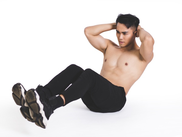 fitness model exercising sit ups and