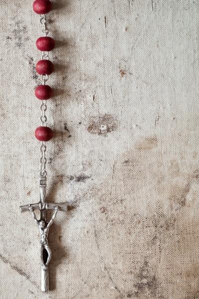 catholic rosary hanging on old canvas