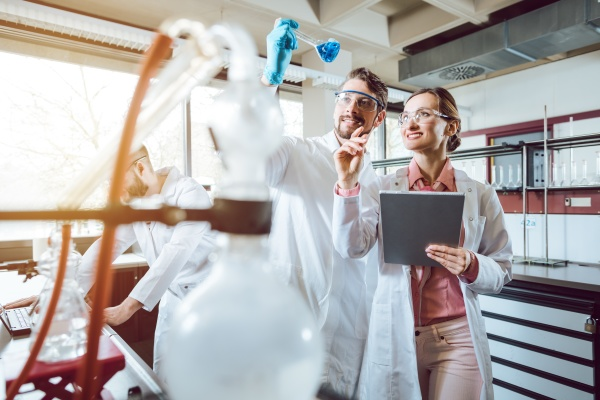 two chemical scientists during breakthrough experiment