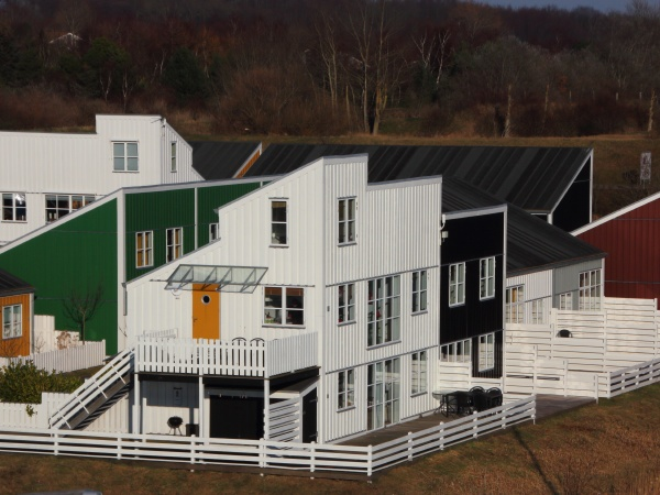 colorful houses with fences in aerial