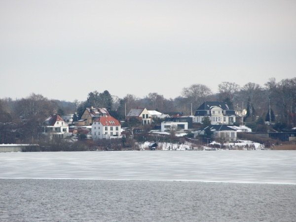 winter lake with houses water and