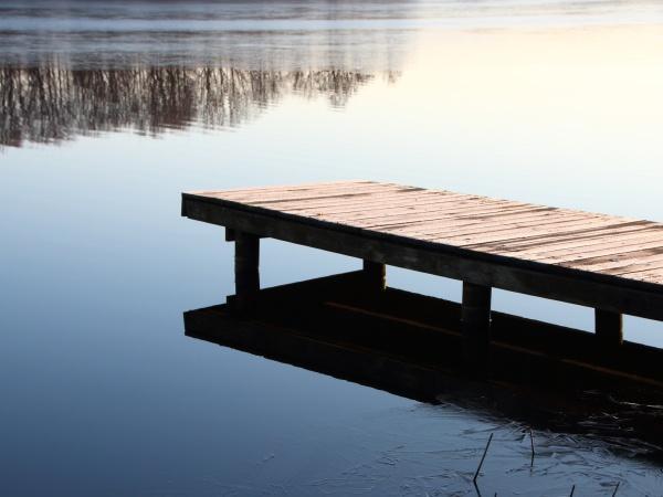 wooden pier bridge at silent winter