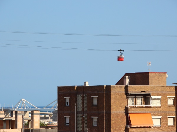 cable car over barcelona with sky