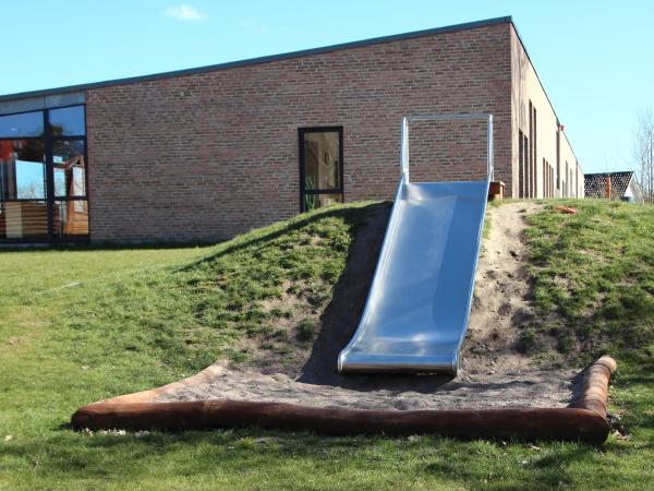 metal slide with blue sky at