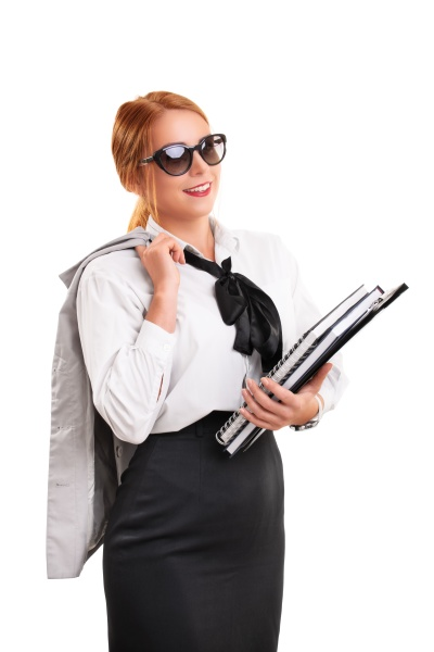 young fashionable businesswoman holding notebooks and