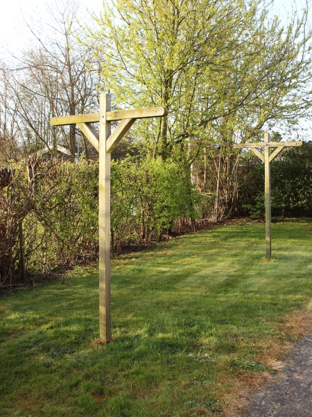 wooden drying rack on lawn in