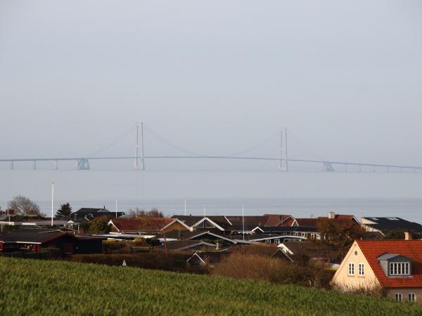bridge over large belt in fog