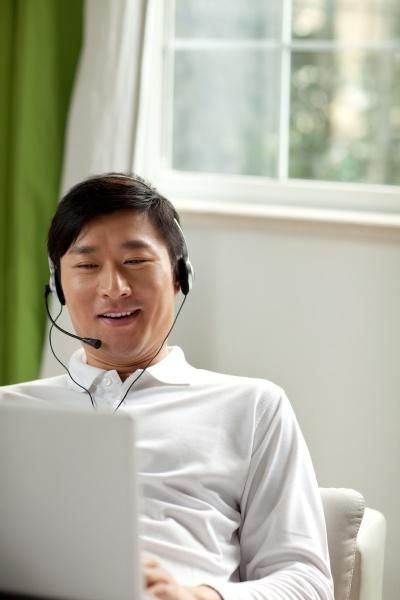 headphones alone a man oriental figures