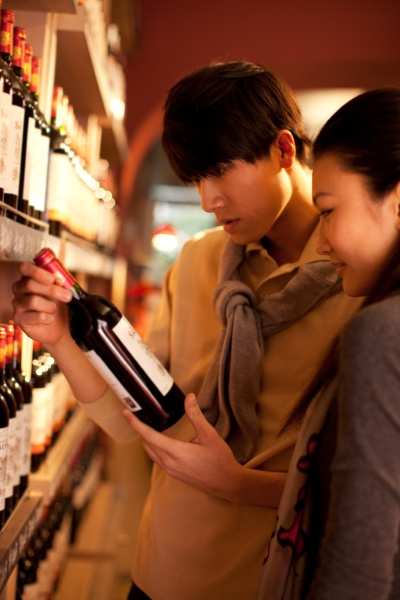 young men wine bottle arrange young