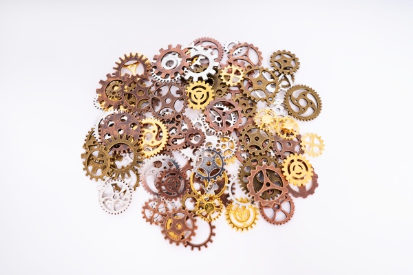 pile of gear wheels and cogs