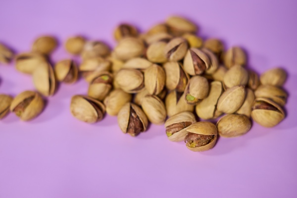 portion of salted open pistachios on