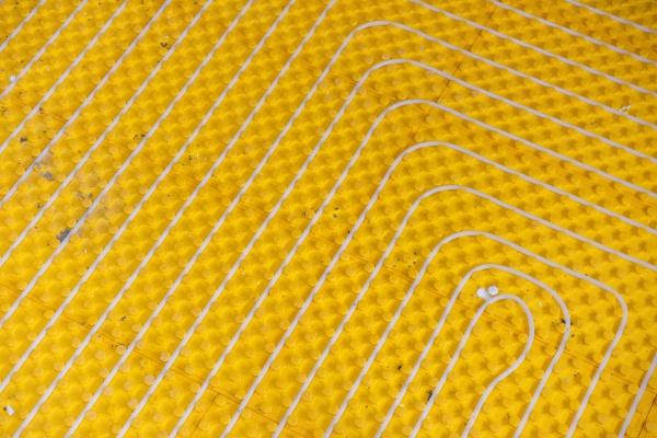 yellow underfloor heating installation with white