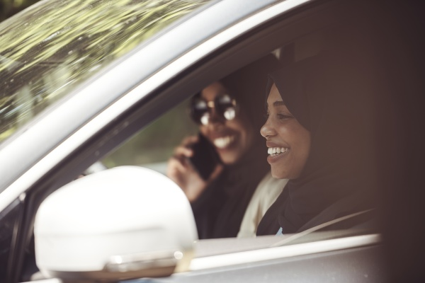arabic woman couple traveling by car