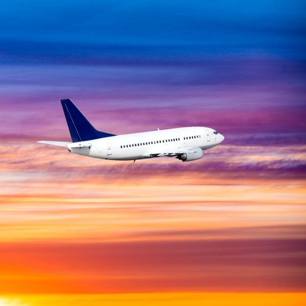 airplane on sunset background passenger airliner