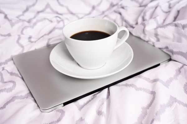 cup of coffee and laptop on
