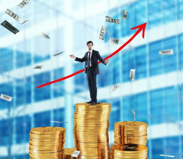 businessman draws growing arrow of company