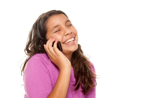 happy pretty hispanic girl on cell