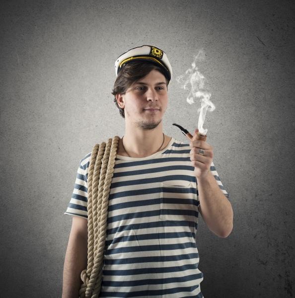 sailor smoking a pipe before sea