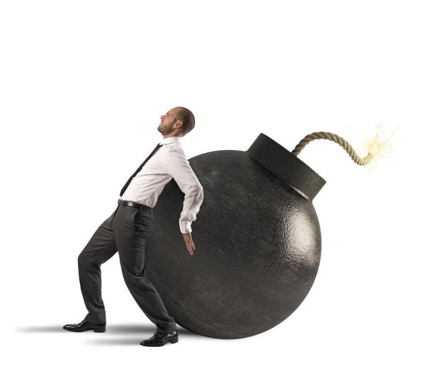 businessman pushing a bomb
