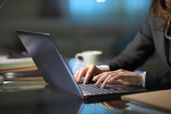 tele worker hands typing on laptop