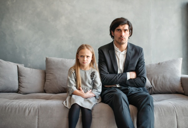 father and daughter both annoyed and
