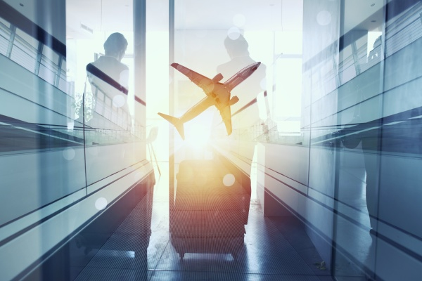 silhouettes of businessman at the airport