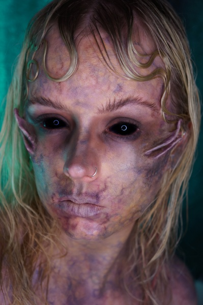 blond woman with scary sfx makeup