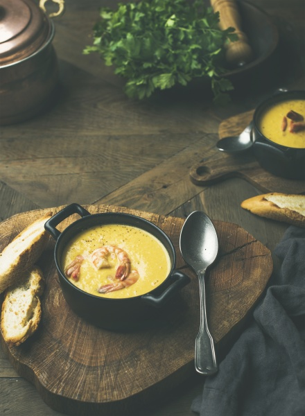 corn creamy soup with shrimps served
